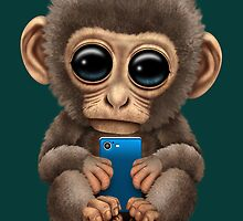Cute Baby Monkey Holding a Blue Cell Phone  by Jeff Bartels