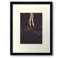 Hanging in space Framed Print