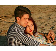Woman in the arms of her lover on the beach Photographic Print