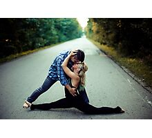 Young man kissing sweetheart in the middle of the street Photographic Print