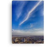 sky above the town Canvas Print