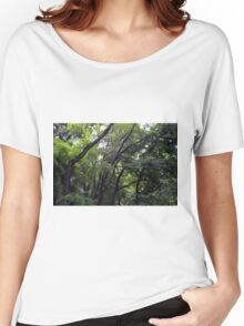 Forest background with many trees tops with green leaves. Women's Relaxed Fit T-Shirt