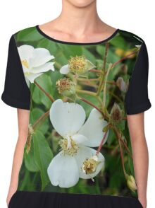 Small white delicate flowers and green leaves. Chiffon Top