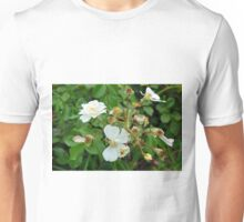 Small white delicate flowers and green leaves. Unisex T-Shirt
