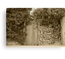 Wood Gate in a Wall of Stones Canvas Print