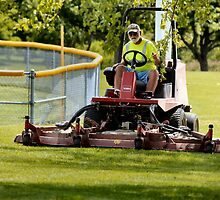 Mowing the Park by Keala