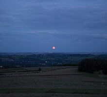 Rare Strawberry moon over the Peak District National Park by Keith Larby