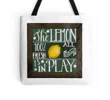 The lemon is in play! Tote Bag