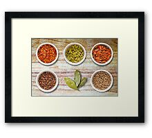 Spices in Pots on Old Wooden Chopping Board Framed Print
