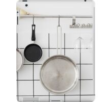 Frying pans hang on a wall of a domestic kitchen  iPad Case/Skin