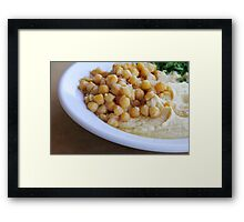 Hummus. A Levantine Arab dip or spread made from cooked, mashed chickpeas,  Framed Print
