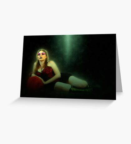arrogant model in red corset reclining on a black leather couch  Greeting Card