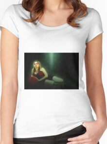 arrogant model in red corset reclining on a black leather couch  Women's Fitted Scoop T-Shirt