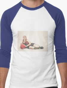arrogant model in red corset reclining on a black leather couch  Men's Baseball ¾ T-Shirt