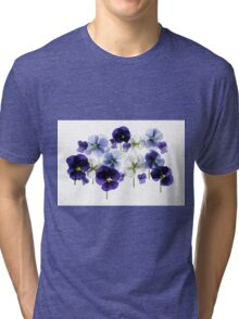 backlit pansy petals on a lightbox  Tri-blend T-Shirt
