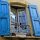 Blue shutters on window Southern France by KSKphotography