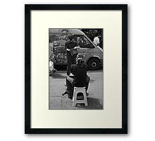 The busker Framed Print
