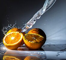 Water stream on orange by Yorkwaypictures