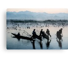 Myanmar, Shan state, Inle lake, fishermen fishing by traditional fishing techniques at dusk  Metal Print
