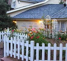 A Pretty Little House With Pretty Little Flowers And A White Picket Fence by Michelle Burley