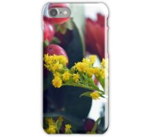 Natural background with small yellow flowers and red fruits. iPhone Case/Skin