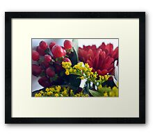 Natural background with small yellow flowers and red fruits. Framed Print