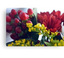 Natural background with small yellow flowers and red fruits. Canvas Print
