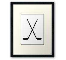 Crossed hockey sticks Framed Print