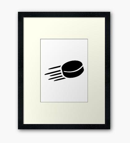 Hockey puck Framed Print