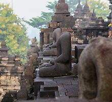 Headless Buddhas. Borobudur, Indonesia. by Keith Thomson