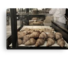 French croissants displayed in Paris bakery window. Canvas Print