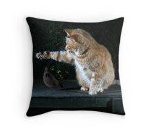 Ginger cat playing with toy mouse Throw Pillow