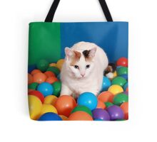 Cat Playing in balls Tote Bag
