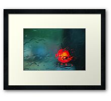 Brake lights through water Framed Print