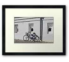 bicycle at a white wall Framed Print