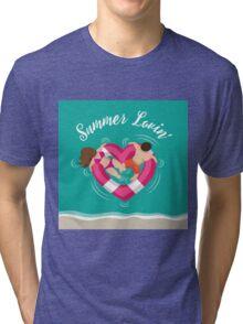 Summer lovin couple in heart shaped inner tube Tri-blend T-Shirt
