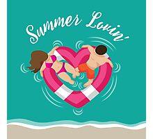 Summer lovin couple in heart shaped inner tube Photographic Print