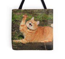 Ginger cat playing Tote Bag