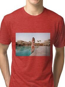 young woman by the swimming pool  Tri-blend T-Shirt