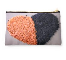 Red and black lentils forming a valentine heart shape for healthy living  Studio Pouch