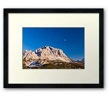 moon is rising behind the mountains Framed Print