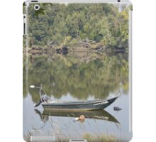 Empty fishing boat on the River Minho in Portugal iPad Case/Skin