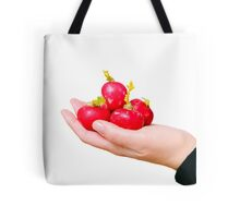 Hand offering a few radishes  Tote Bag