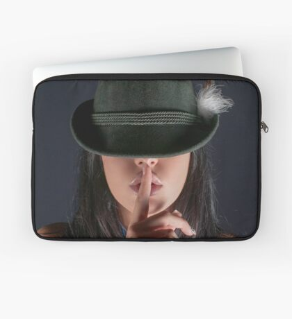 young woman in her 20s gesturing silence by placing a finger to her lips  Laptop Sleeve