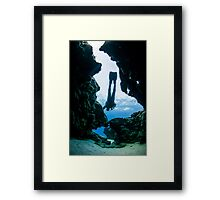 silhouette of a Divers exploring natural caves Framed Print
