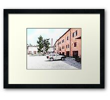 Brisighella: courtyard and building with pink facade Framed Print