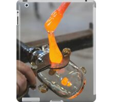 Glassblower cuts molten glass with a hand tool iPad Case/Skin