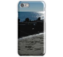 Silhouette of line of inflatables on beach iPhone Case/Skin