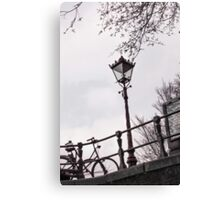 Lamp along Amsterdam canal bank Canvas Print