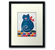 Cat with a red bow Framed Print
